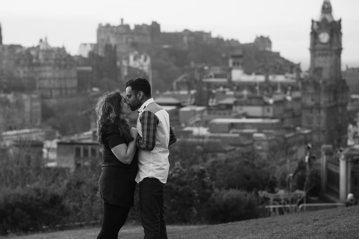 Karen kissing Sahir with Edinburgh skyline
