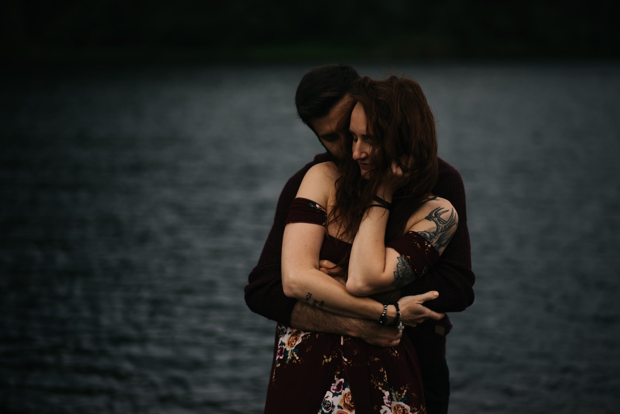 close embrace with lake in background