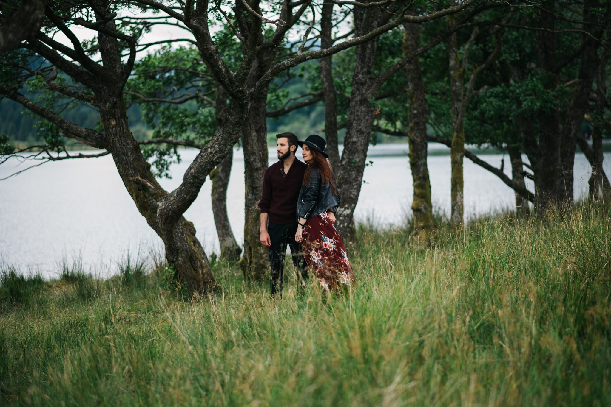 couple by lakeside with trees