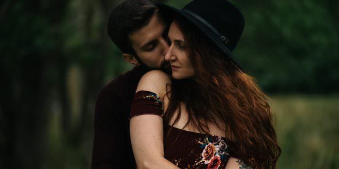 couple embracing with hat