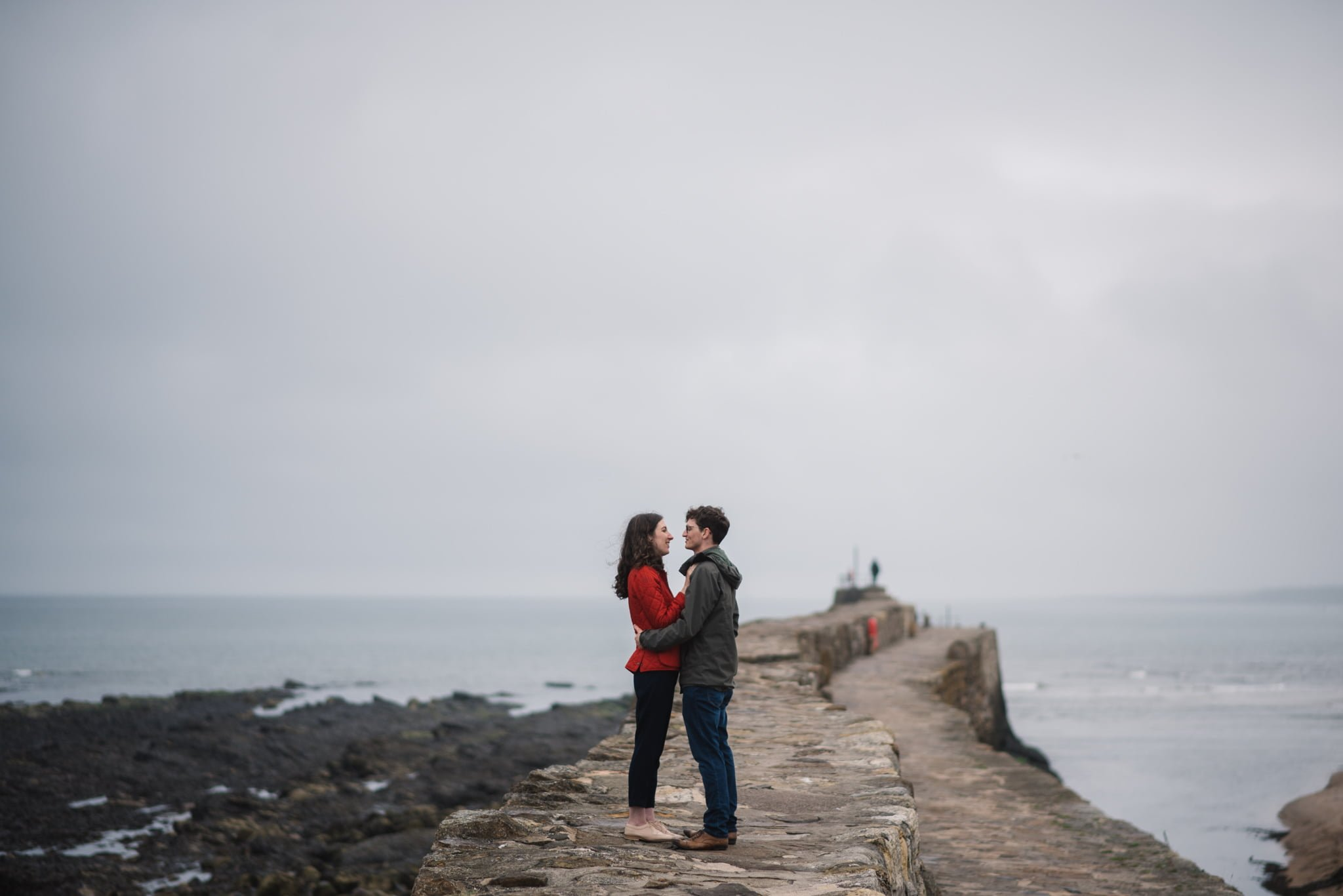 couple standing seawall