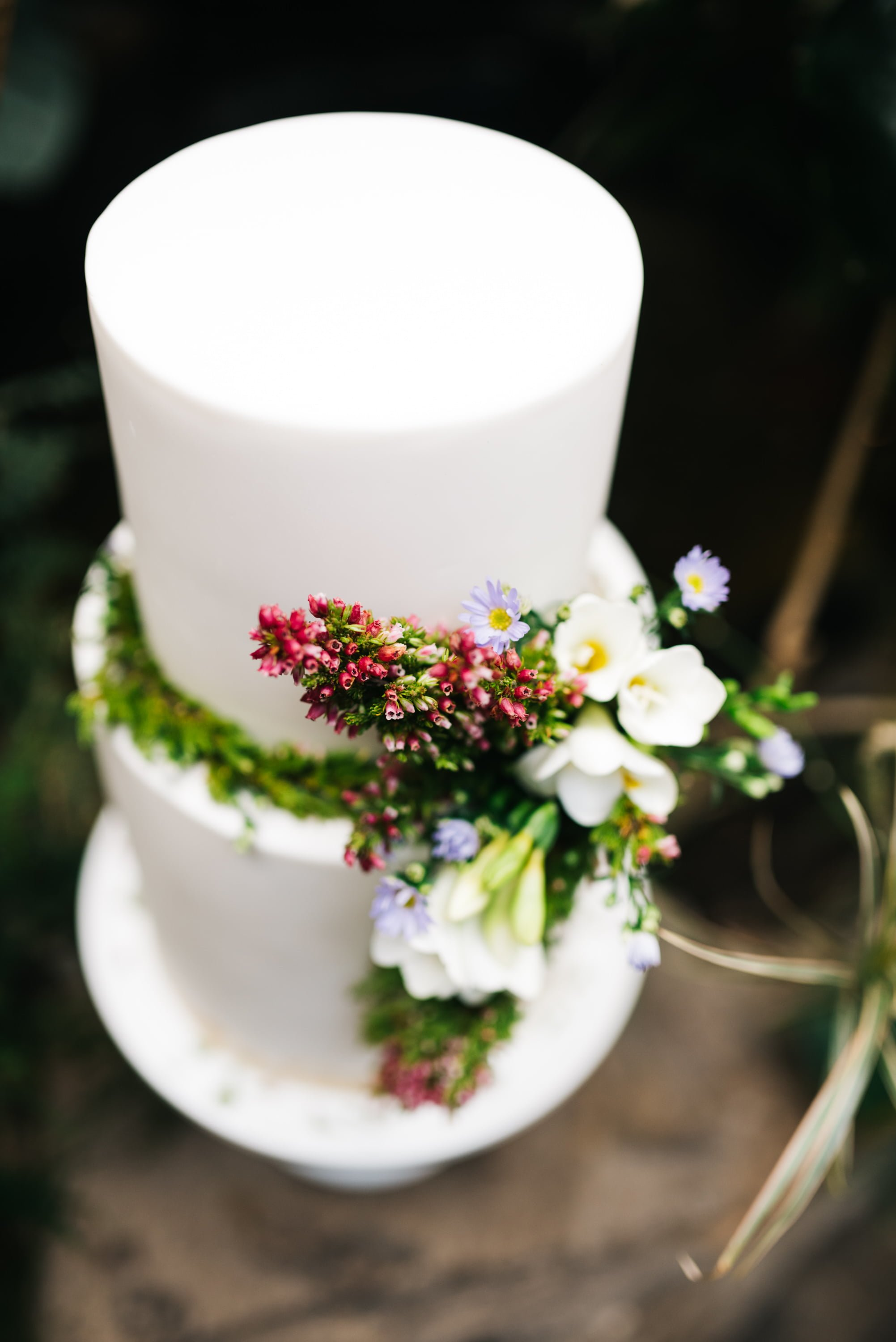wedding cake with foliage and floral details