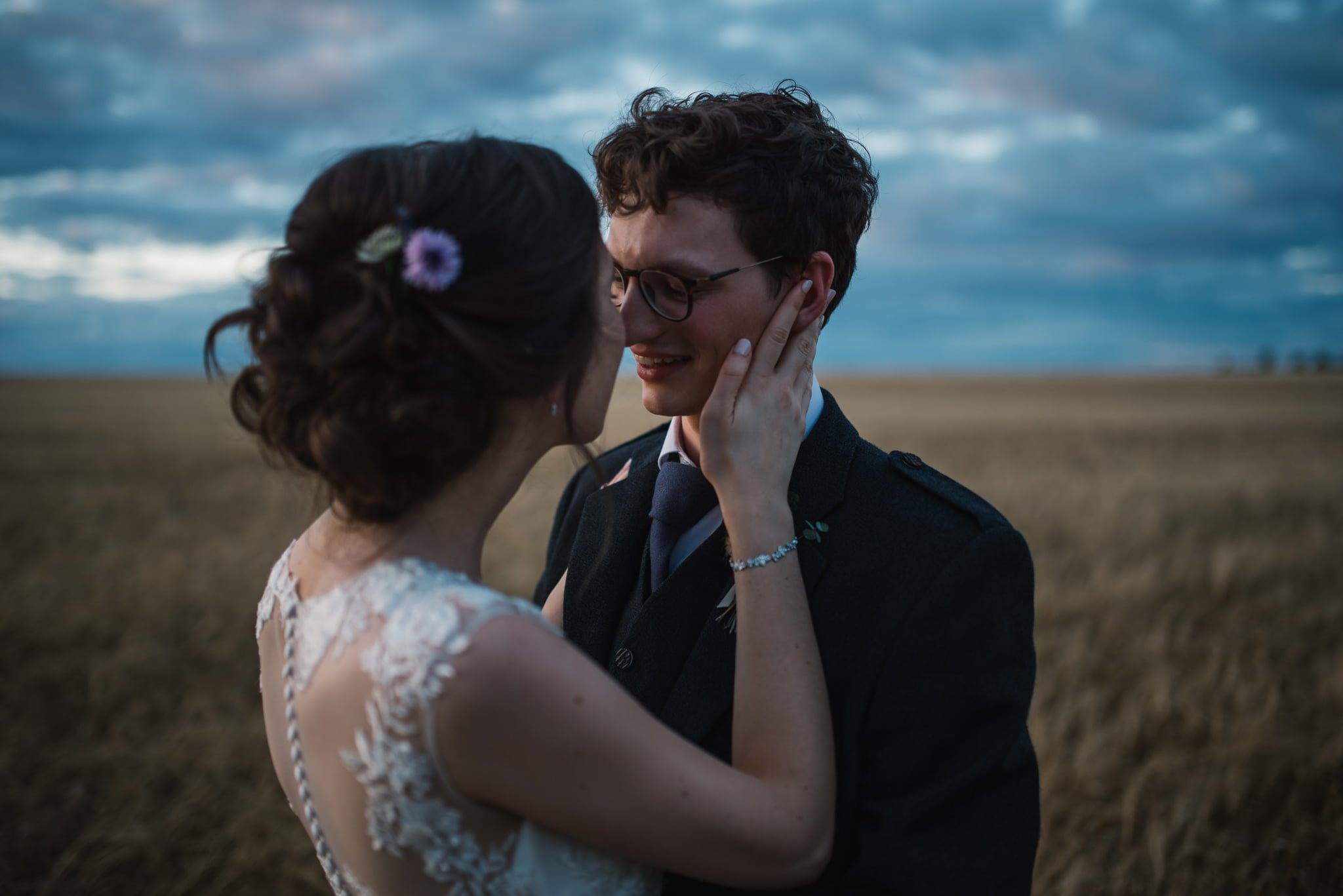 couple in a barley field about to kiss