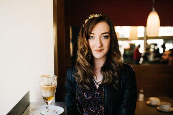 iona fyfe with coffee and tiara