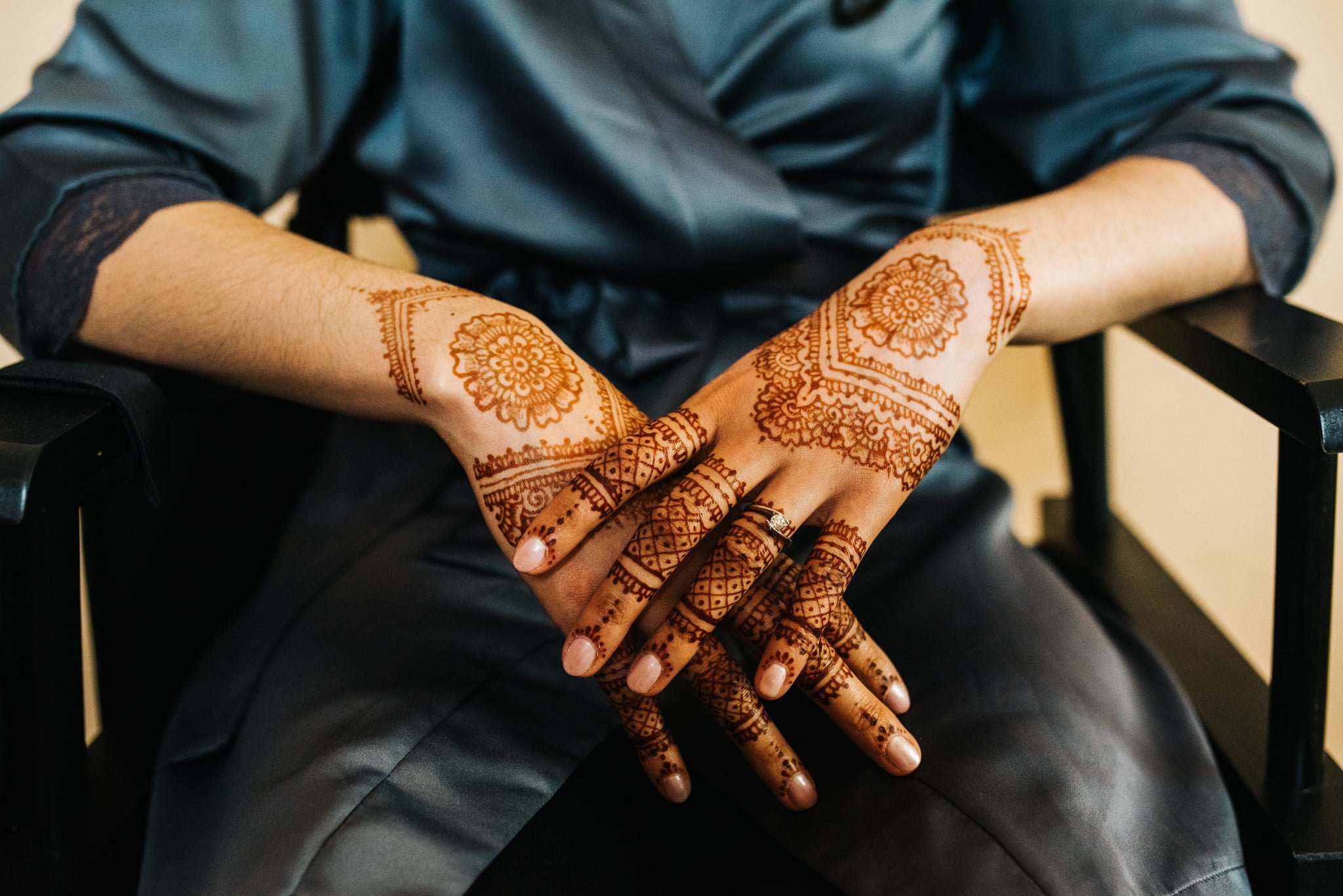 bride's hands decorated with henna