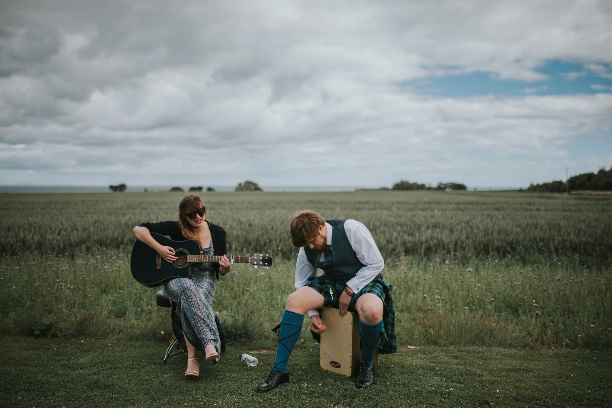 wedding guests playing music in a field