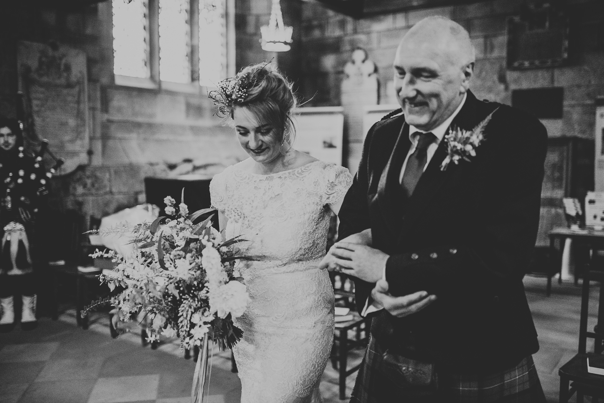 father leads bride down the aisle