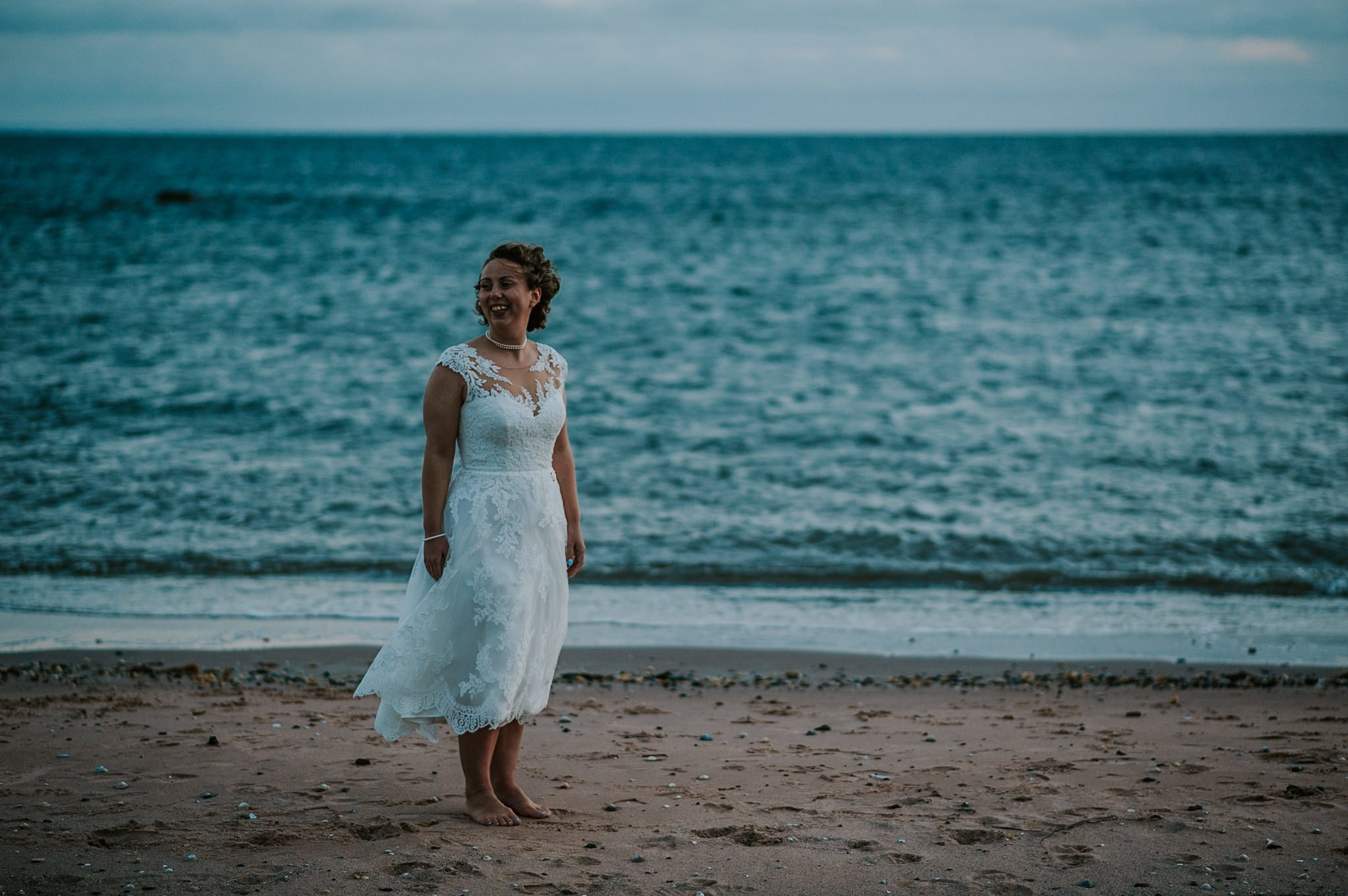 bride on the beach in the evening light