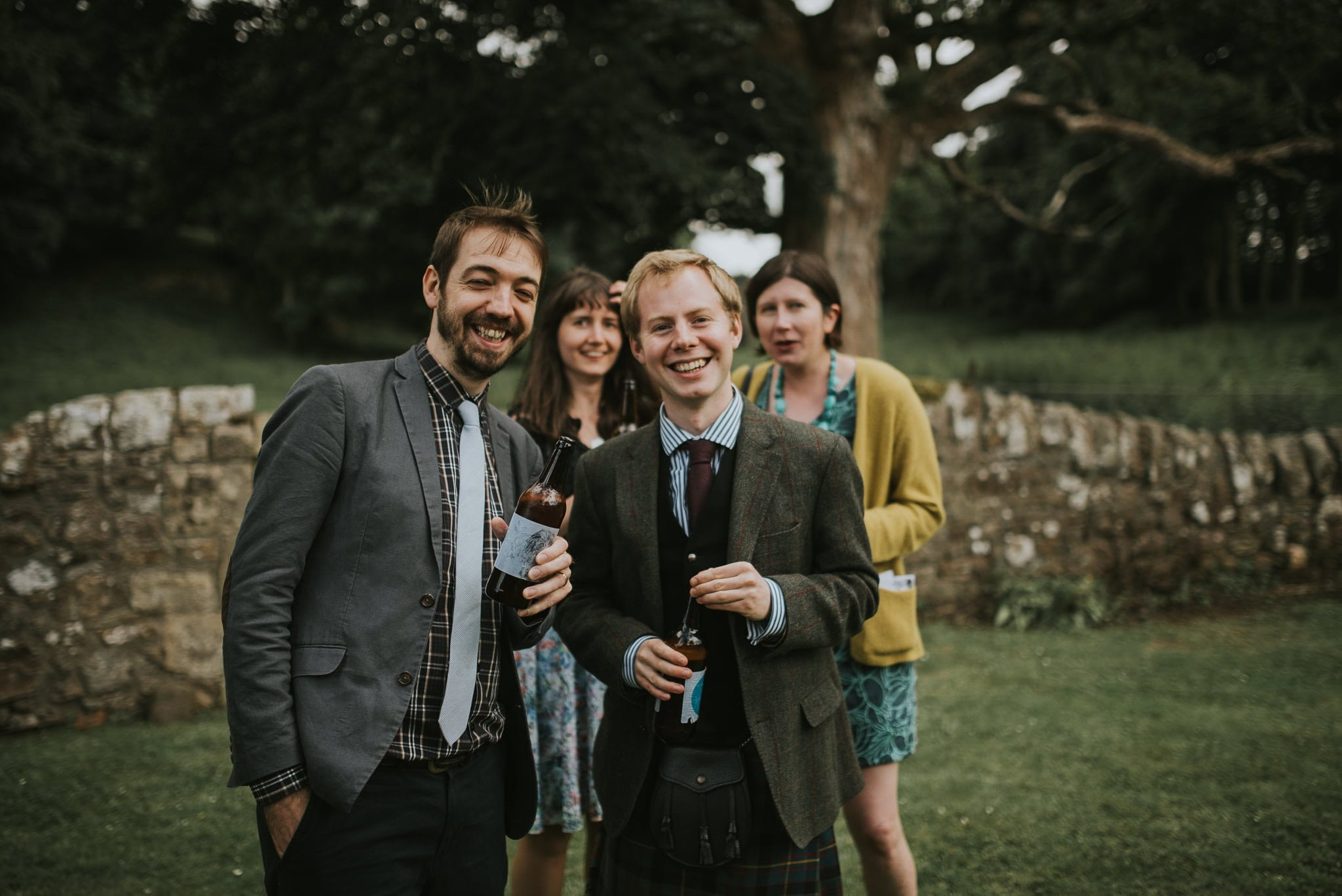 guests enjoying a beer at a wedding reception