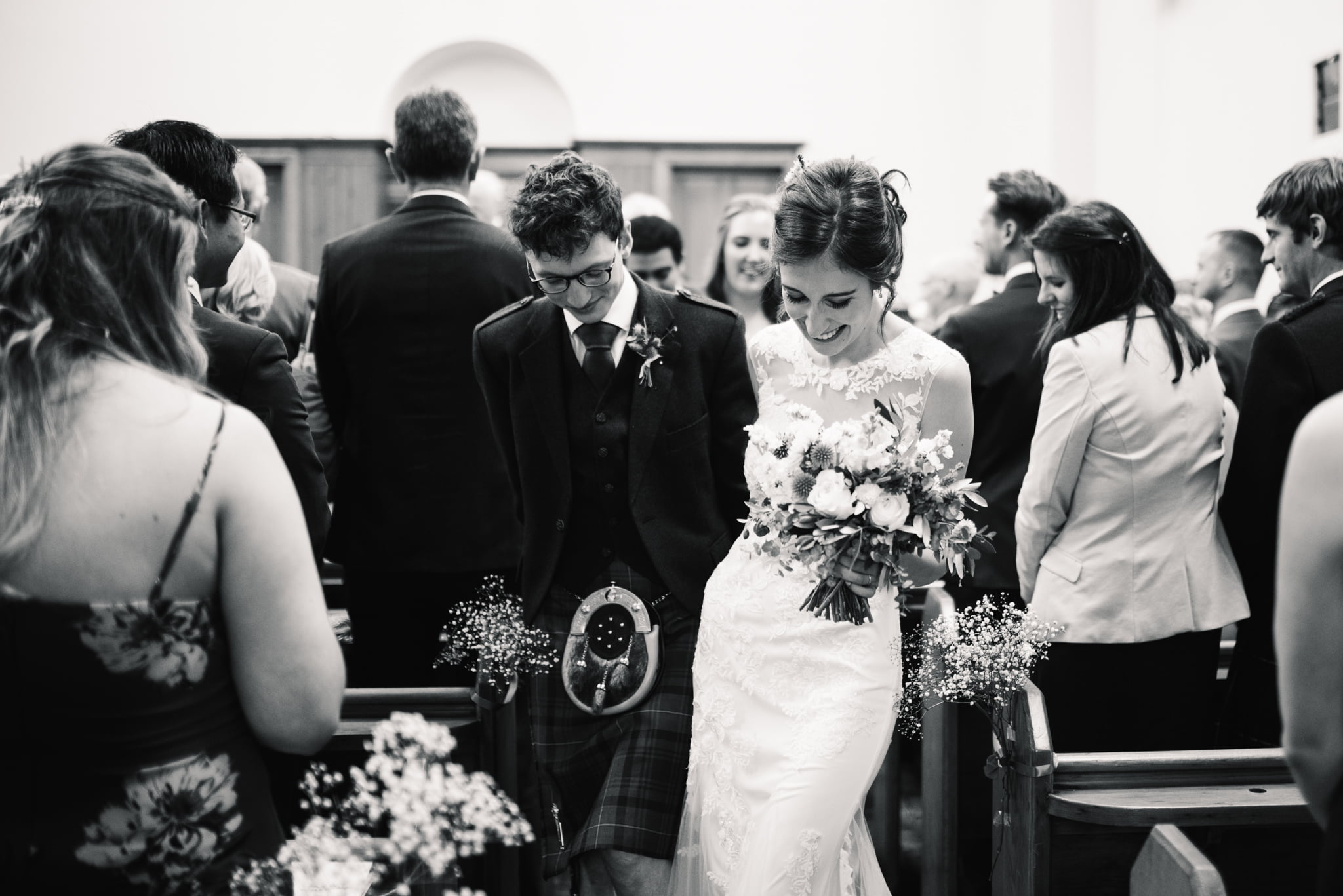 newly married couple walking down the aisle