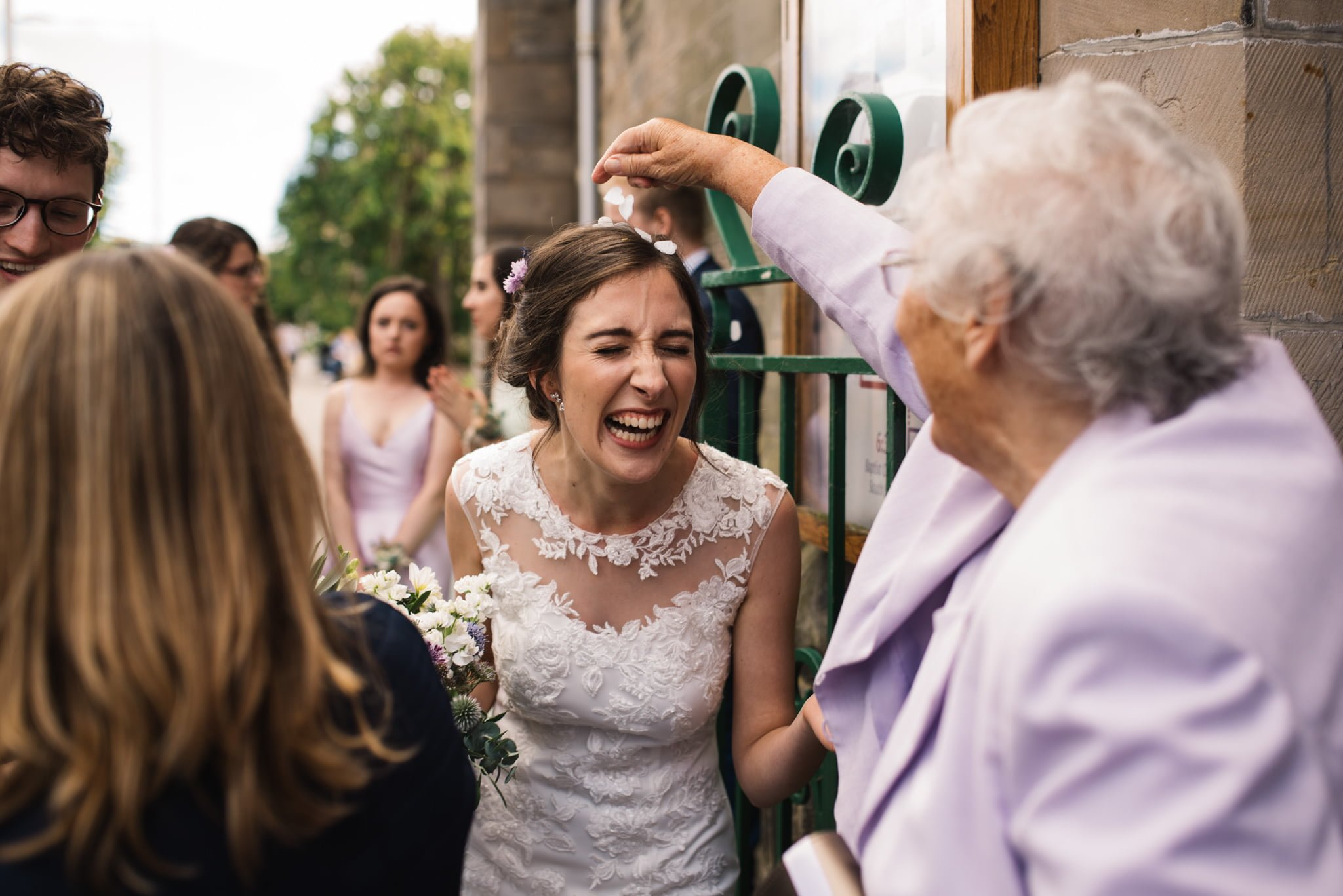 bride with grandmother and confetti