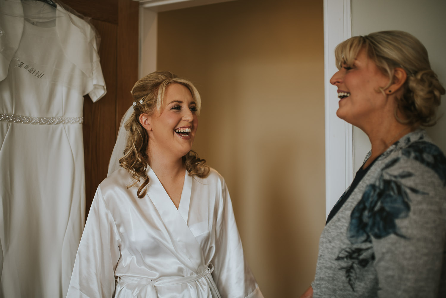 country wedding bride laughing with mother