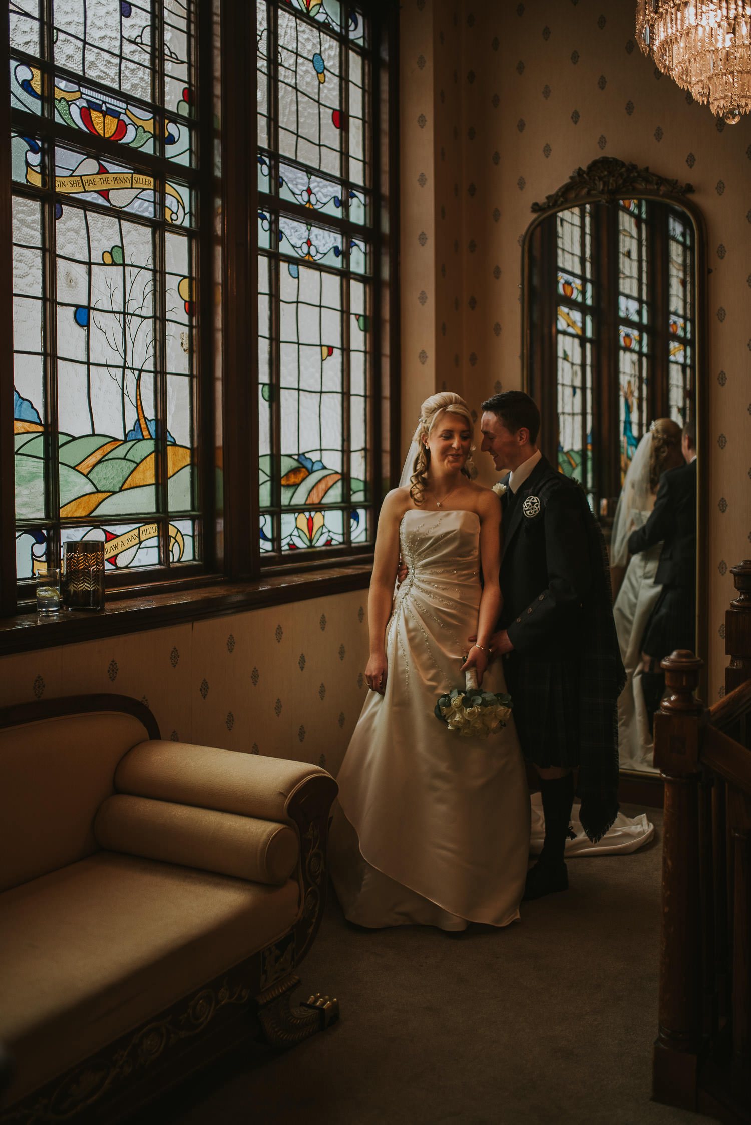 country wedding couple at stain glass window