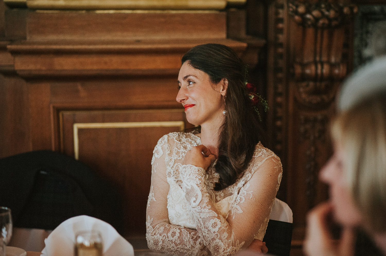 bride smiling at groom during speeches