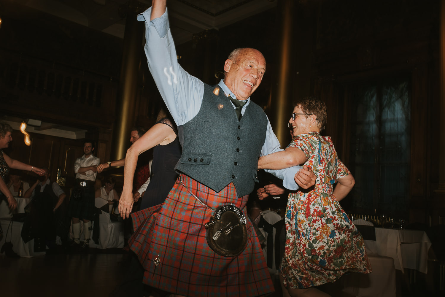 wedding guests whirling during ceilidh