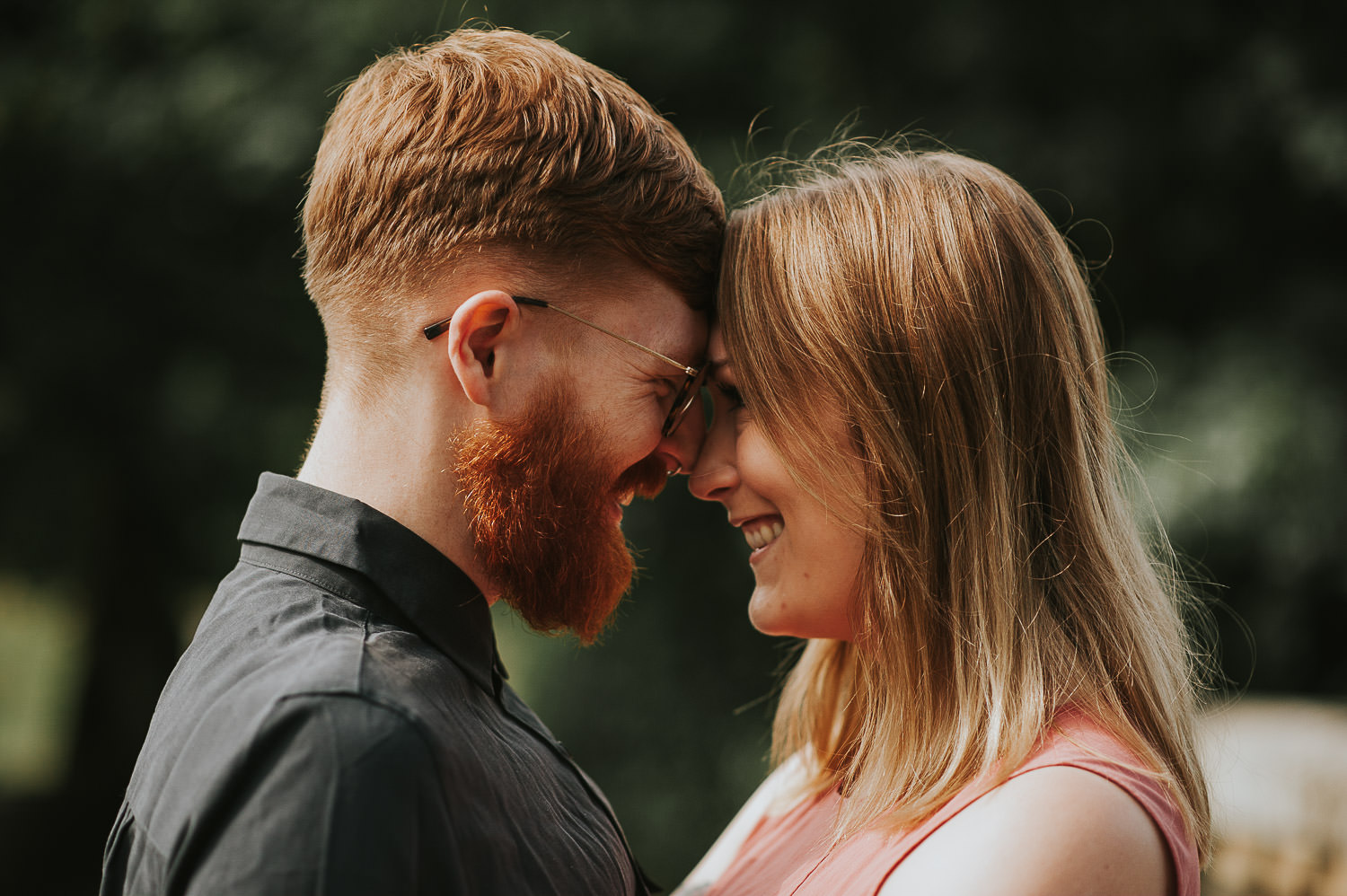 engagement shoot couple smiling with foreheads together