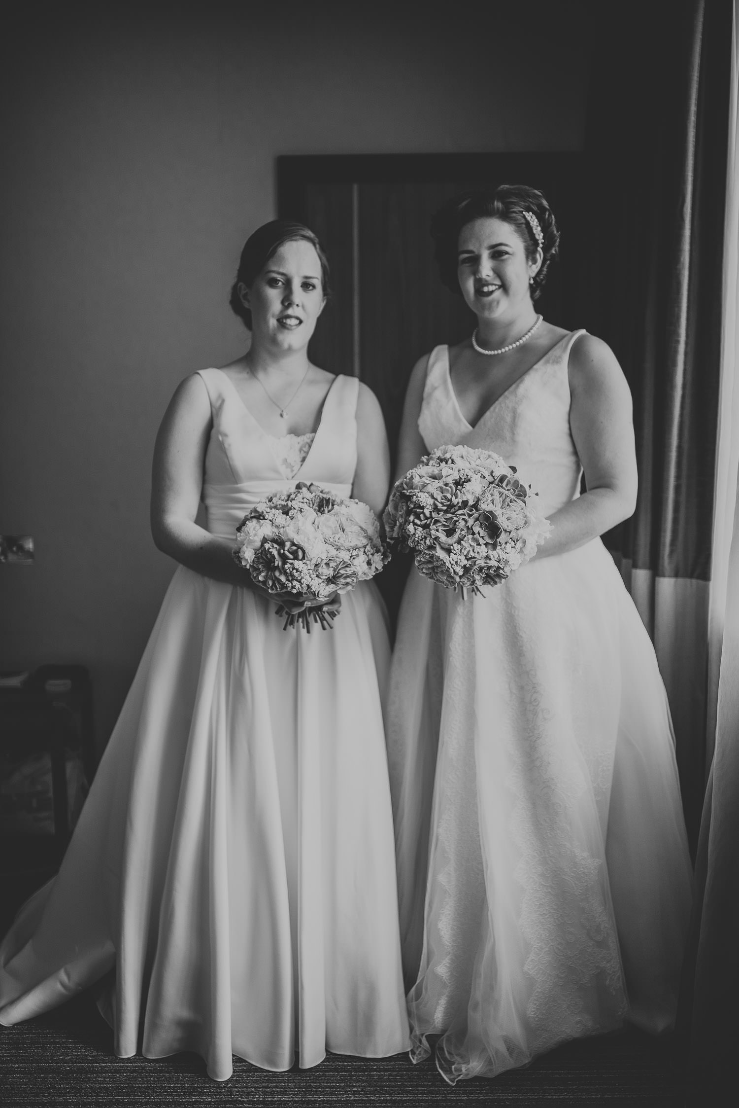 portrait with both brides