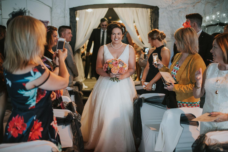 first bride walks down the aisle
