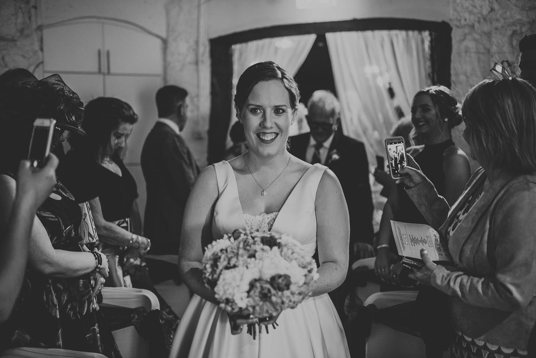 second bride walks down the aisle