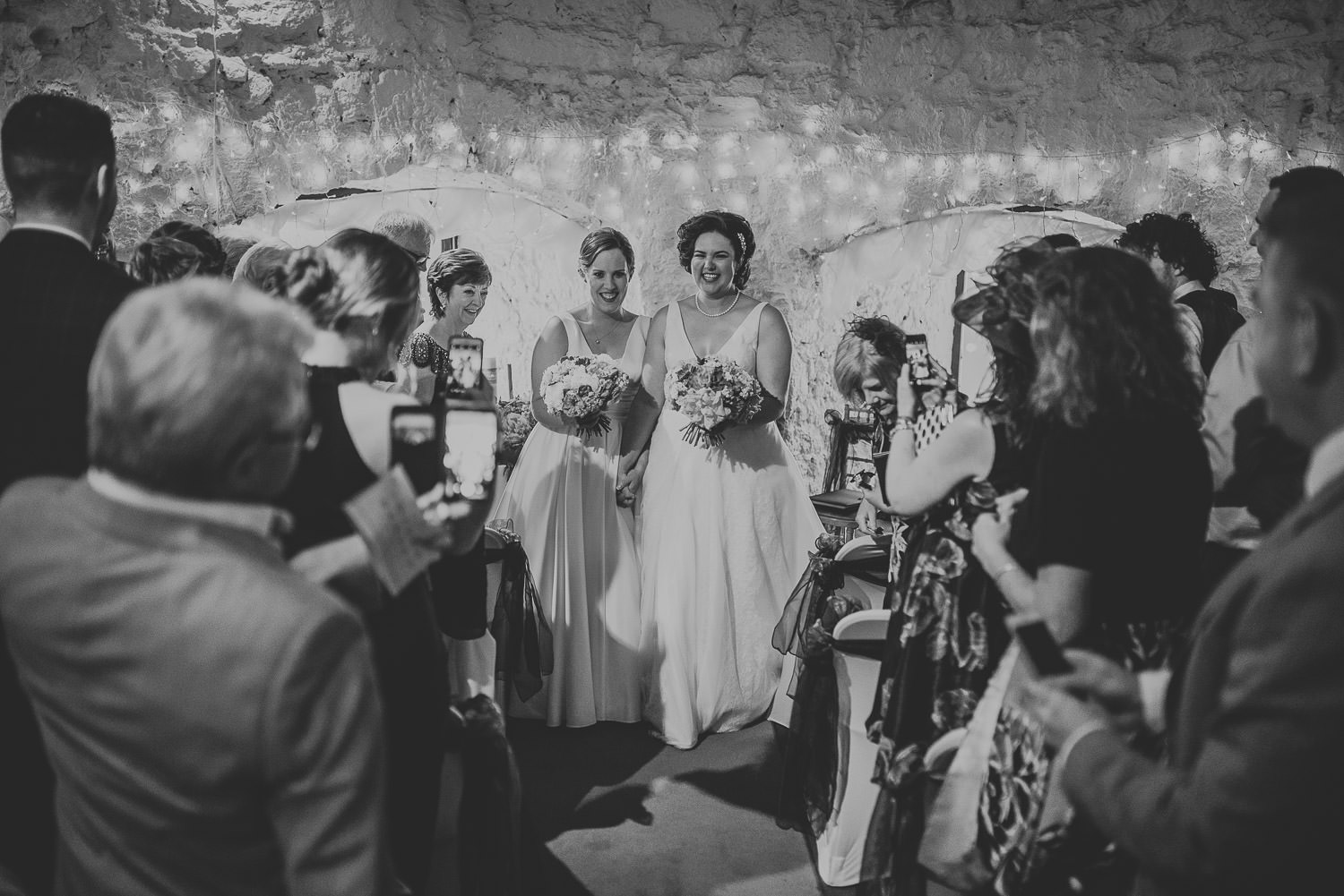 brides walking down the aisle together