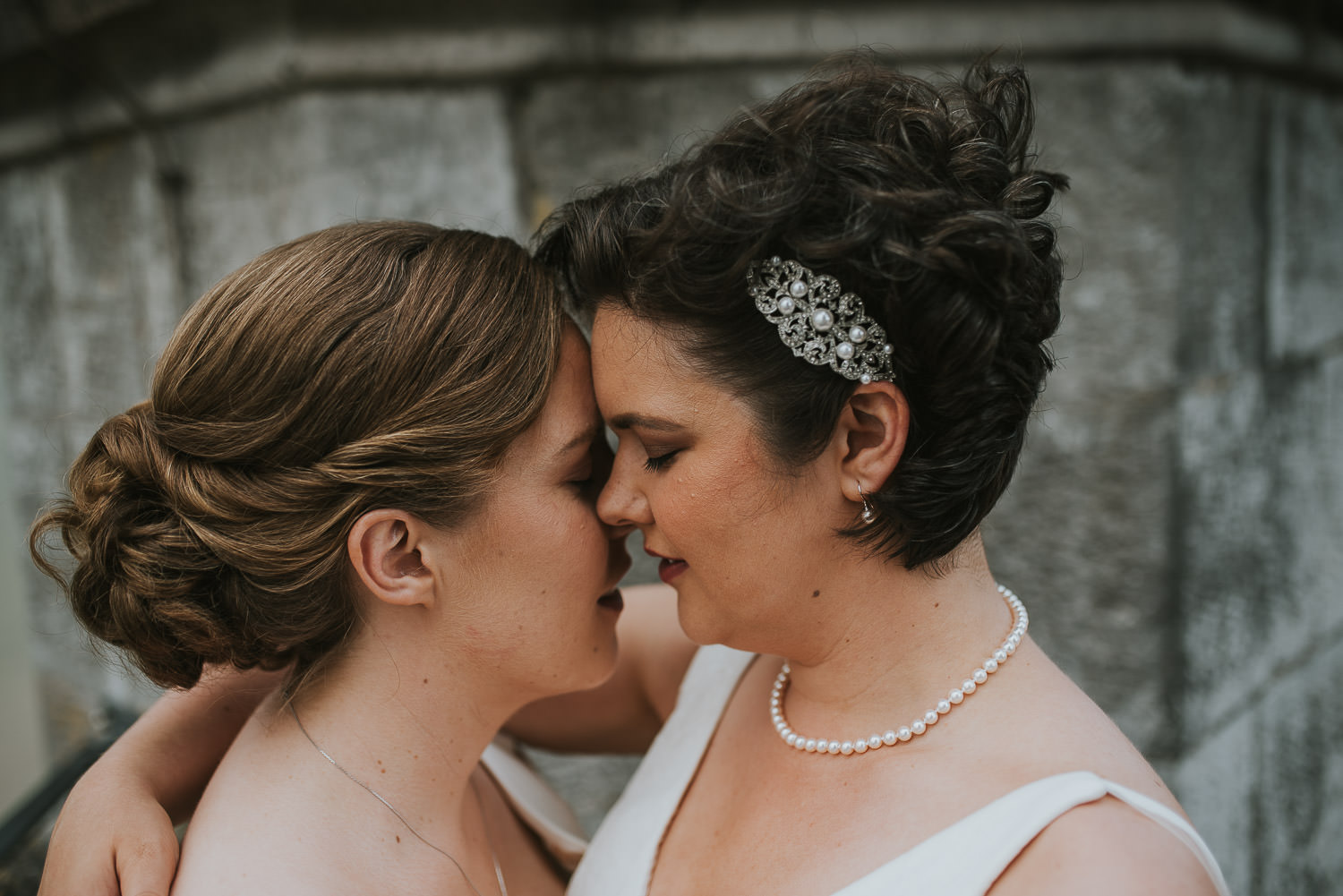 brides leaning in for a kiss