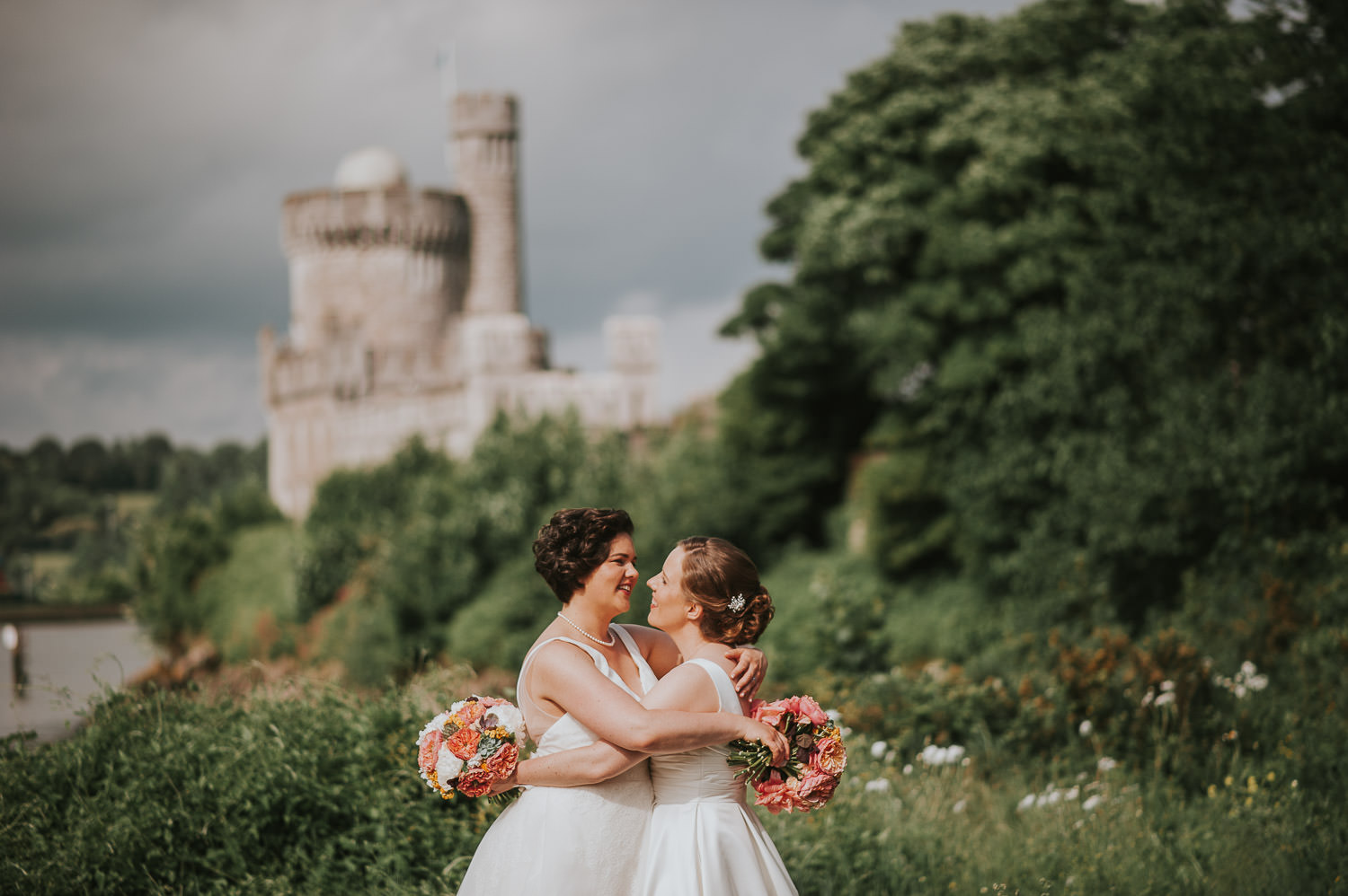 brides in field with blackrock castle in the background