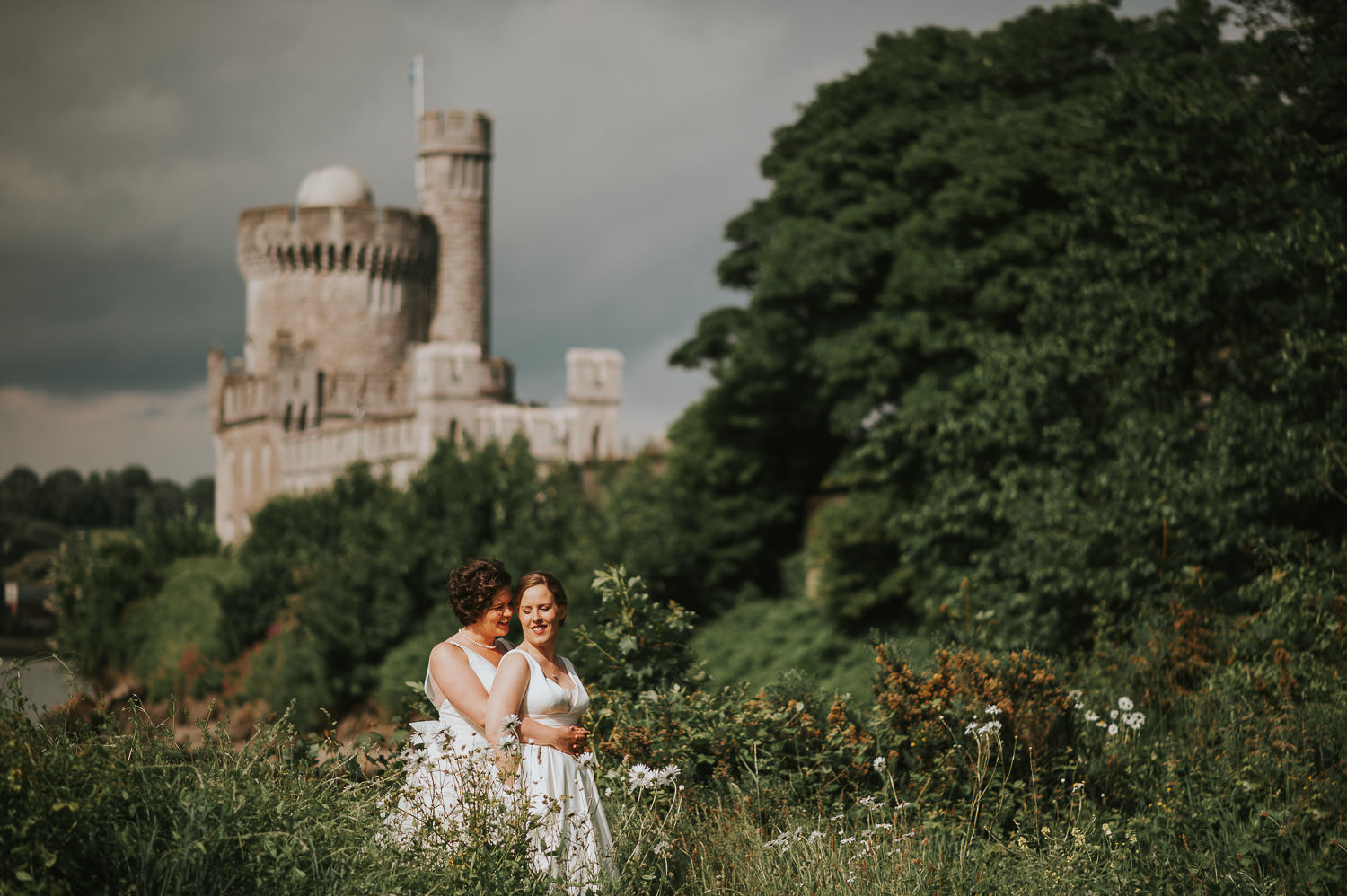 brides in a field with blackrock castle observatory