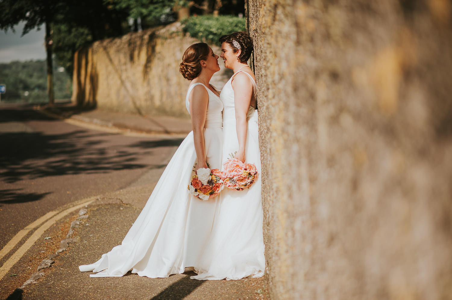 brides standing in front of a wall